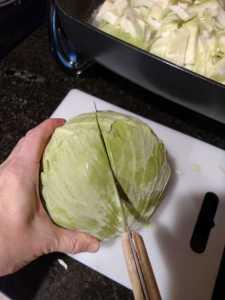 cutting a cabbage in half