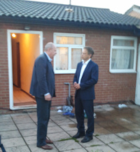 Housing Minister Grant Shapps and Immigration Minister Damian Green outside a rogue landlords property