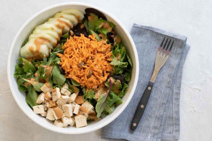 Carrot Raisin Salad with Tahini and Sriracha on salad