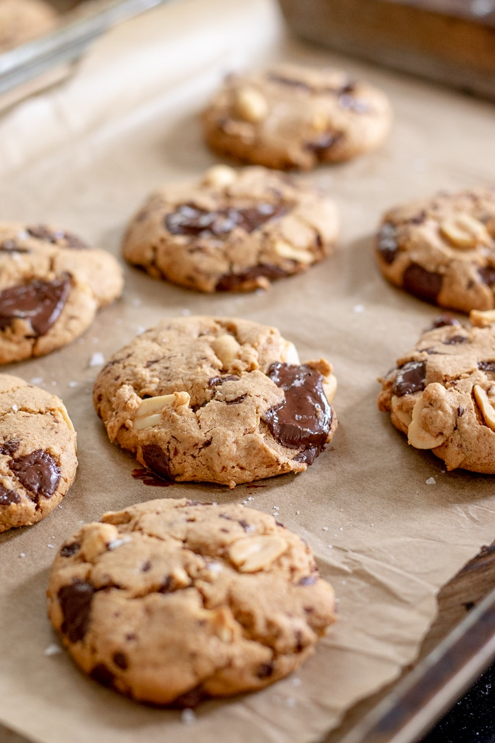 Spelt Cookies With Peanuts and Chocolate on a baking tray