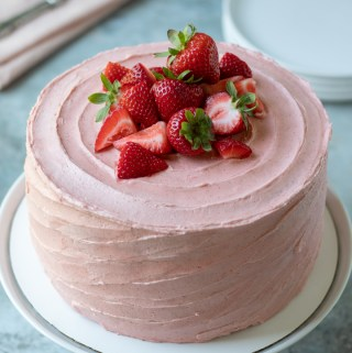 Strawberry Cake on a white cake stand
