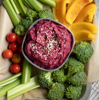 purple sweet potato dip surrounded by raw veggies