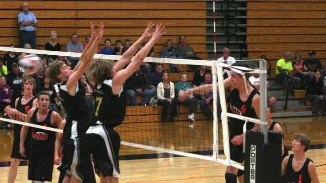 Nolan Rueter slams home a kill in recent action. The 6-foot-5 senior helped lead Burlington to a 3-2 win over Racine Horlick Monday night. The Demons lost the first two games.