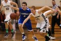 Catholic Central's Gavin Foote (left) and Waterford's Trace Hunsucker battle for a loose ball last year. Hunsucker led the Wolverines in every major category. (Photo by Rick Benavides)
