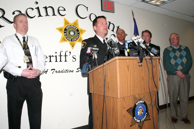 Racine County Sheriff Christopher Schmaling (center) briefs the media Monday along with others who have been involved in the 17-year-old murder case of Amber Gail Creek. Schmaling announced Tuesday that an arrest has been made, and that James P. Eaton has been charged with first degree intentional homicide. (Photo by Jennifer Eisenbart)