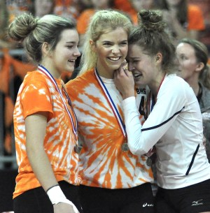 Brooklyn Vandehei (from left), Alyssa Turzenski and Maddie Berezowitz fight back tears after the team's state title loss. (Mike Ramczyk/SLN)