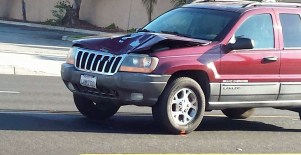 A Jeep Grand Cherokee involved in the fatal accident had heavy front end damage after the collision. Gary Rainwater photo