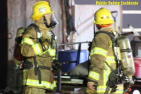 Firefighters discuss the fire after it was extinguished. Robert Carter photo