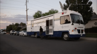 A sheriff's official exits a Sheriff's mobile command center. John Strangis photo