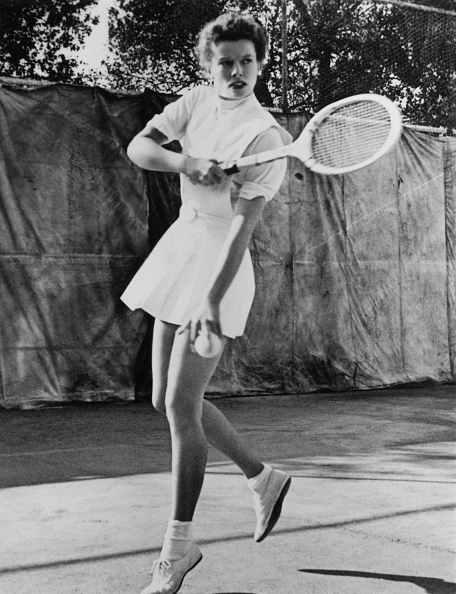 American actress Katharine Hepburn (1907 - 2003) playing tennis, circa 1935. (Photo by Hulton Archive/Getty Images)