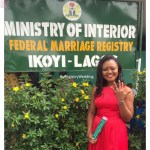 Bride shows off both her wedding ring and certificate