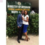 Bride stylishly shows off her ring as she pose with the Groom