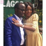 Bride stylishly flaunts her ring as she place her hand on the groom