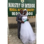 Couple happily shows off their marriage certificate