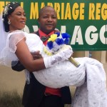 Capable groom carrying the Bride effortlessly