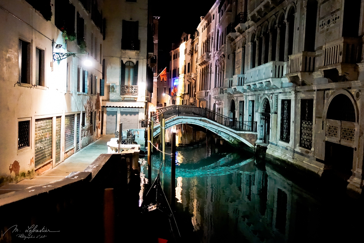 canals of Venice by night in Italy with colorful lightings