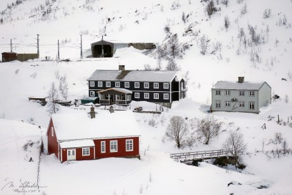 houses in the snow during the Flam railway trip