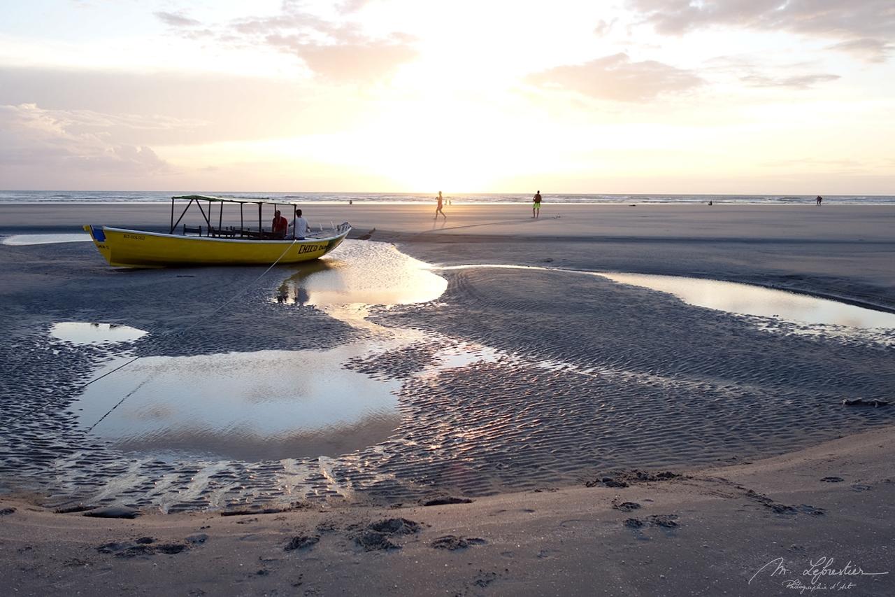 boat on the beach at sunset inJericoacoara Brazil