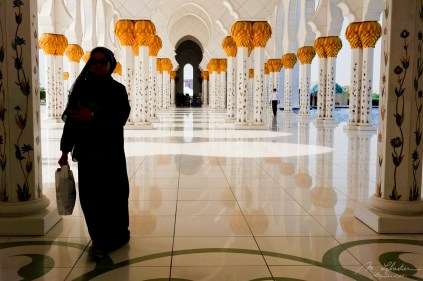 covered woman walking in the grand mosque Abu Dhabi