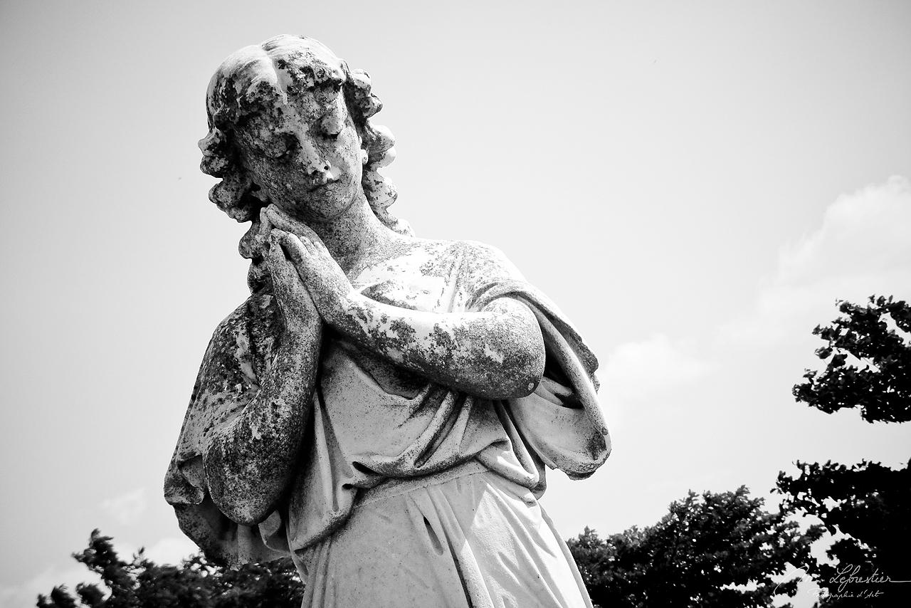 statue in the old cemetery la Reina in Cienfuegos, Cuba