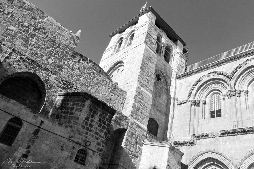 outside view of the church of the Holy Sepulchre in Jerusalem holding the tomb of jesus christ in black and white