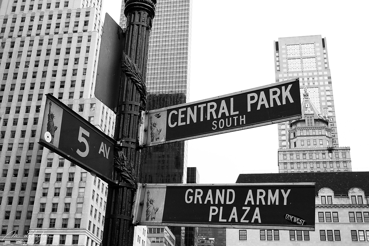 signs of crossing 5th avenue central park south and grand army plaza in new york city NYC USA photo in black and white