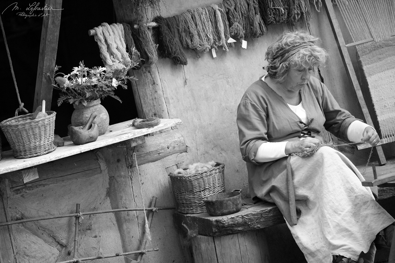 woman working in the Guédelon Castle by Treigny in France