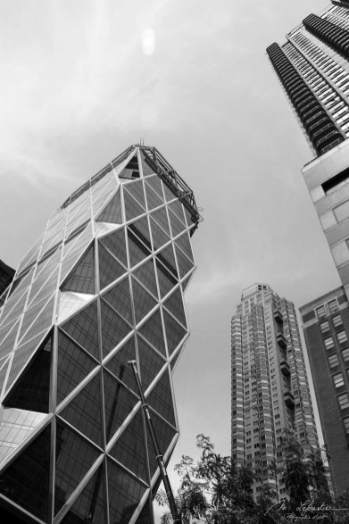Black and white photo of the nusual skyscraper in New York City NYC: the Hearst tower building designed by architect Norman Foster