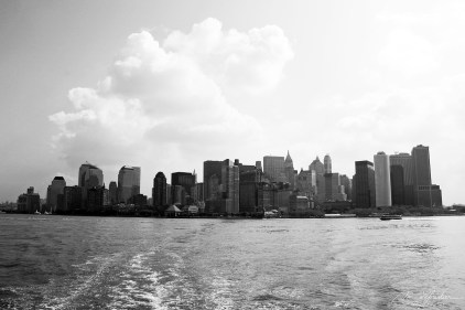 view of new york city from the boat to ellis island NYC USA in black and white