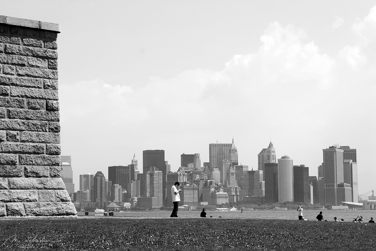 view of new york city from the statue of liberty Ellis island NYC USA in black and white