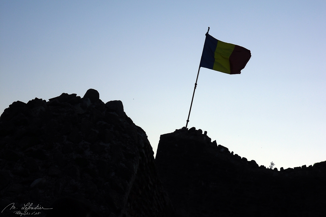 romanian flag on top of the Poenari real castle of Dracula in Romania