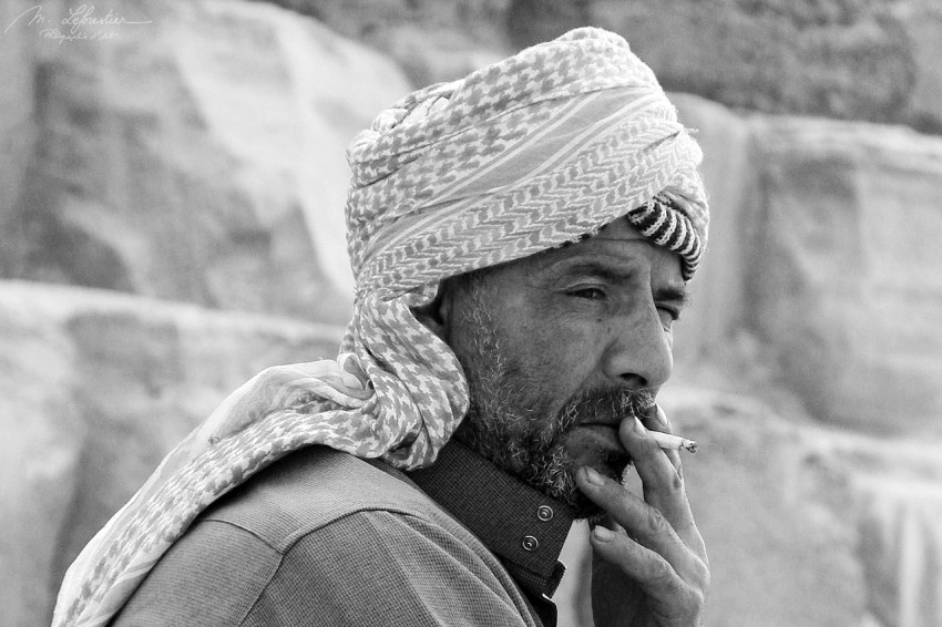bedouin smoking and relaxing at the Great Pyramid of Giza Kufu Cheops