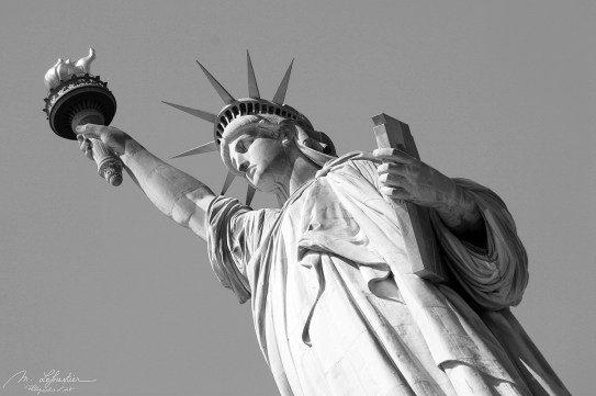 side close up on the statue of liberty national monument in new york in black and white NYC USA