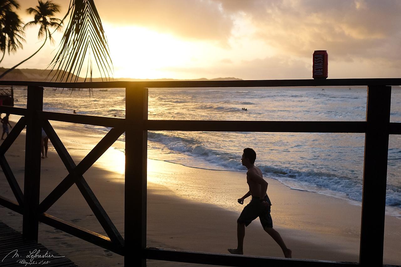 man running on the beach during sunset on the Pipa beach