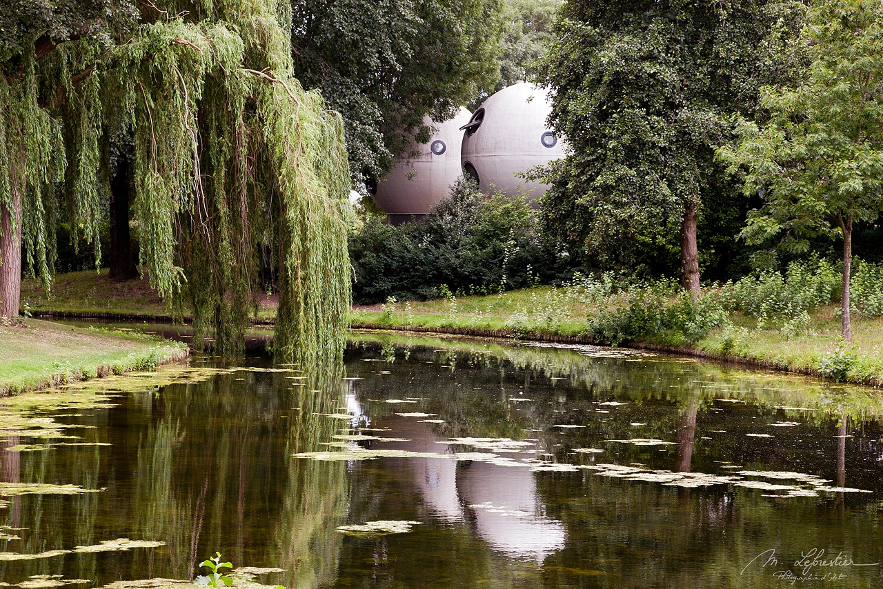 back view with reflections in the water of the spherical houses Bolwoningen in 's-Hertogenbosch Netherlands