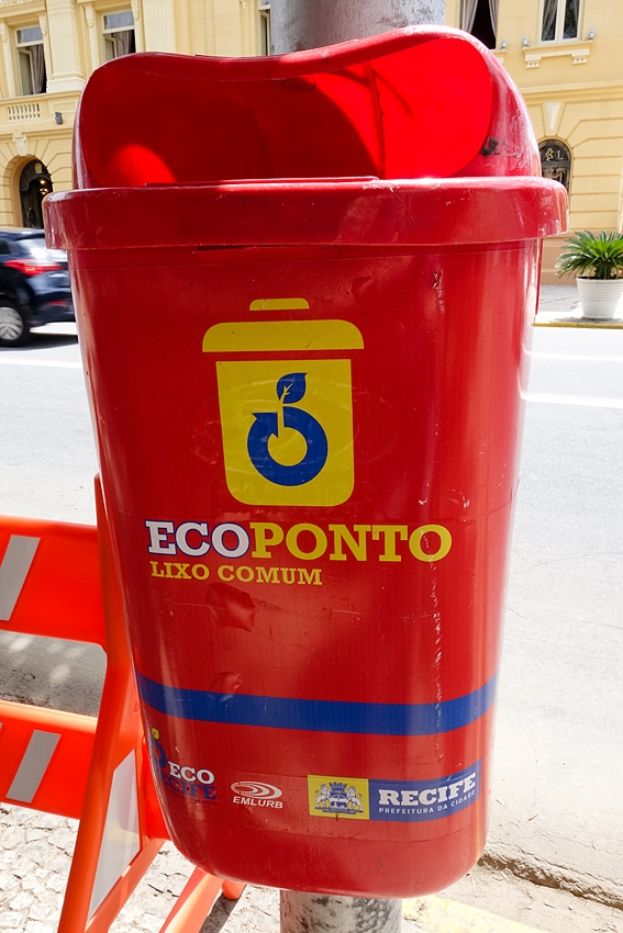a red street trash can in Recife Brazil