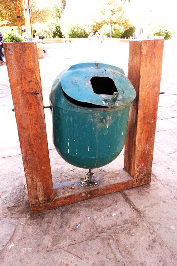a green litter bin in San Pedro de Atacama in Chile