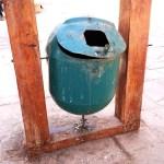 a green litter bin in San Pedro de Atacama in Chile