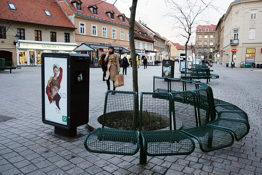 a litter bin with advertisement on it in the very center of Zagreb in Croatia