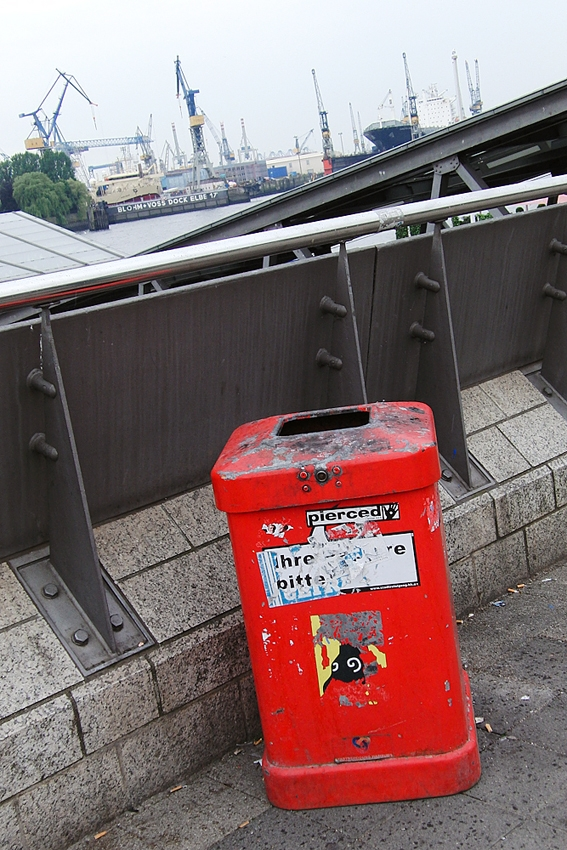 a red litter bin on a bridge in Hamburg Germany
