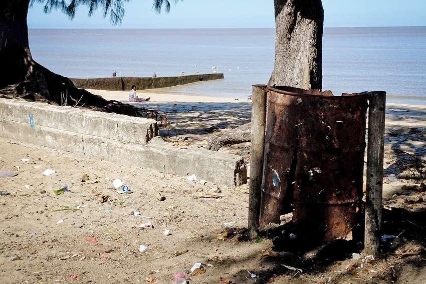 a broken litter bin by the sea indian ocean in Beira Mozambique