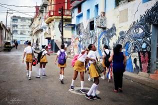 cuban school girls after the study day in a street by the callejon de hamel in la havana Cuba