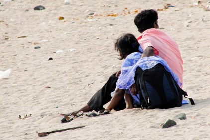sitting on the Mumbai Versova beach in 2011