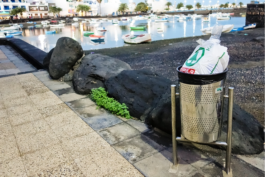 a full metal bin in Areccife on the island of Lanzarote part of Spain