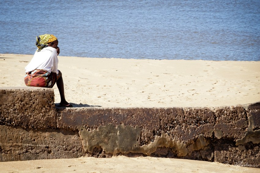 woman sitting by the beach in Beira and watching the Indian Ocean Mozambique