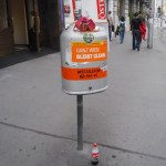a full orange bin in a street of Vienna capital of Austria