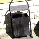 an old black litter bin in a street of Tirapol in Transnistria the country that does not exist, in Moldova