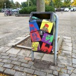 a street litter bin full of colorful stickers in Eindhoven the Netherlands