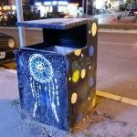 a colorful bin photographed by night in Pristina Kosovo