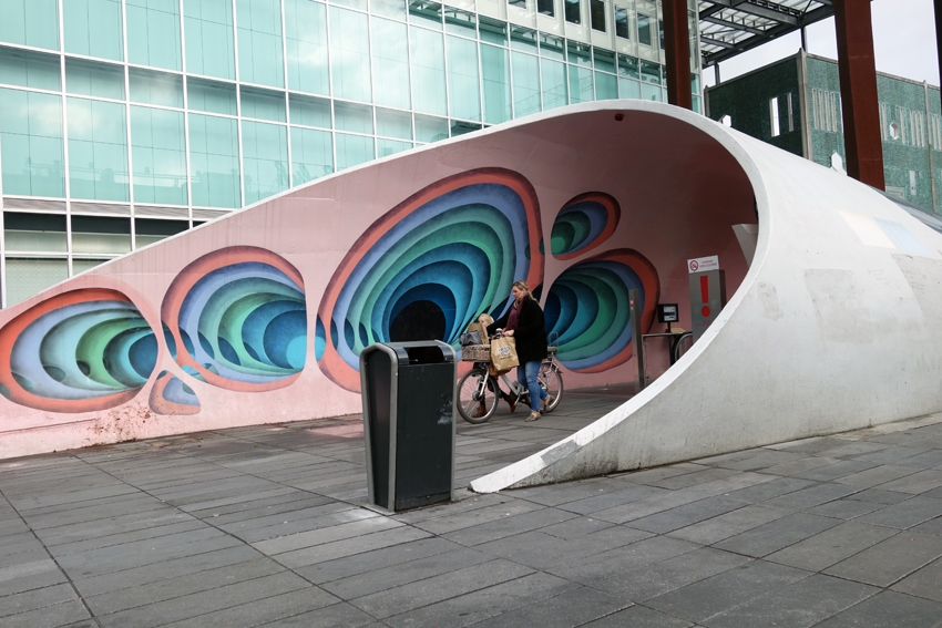 a street litter bin by an underground parking for bicycles in Eindhoven Noord Brabant in the Netherlands
